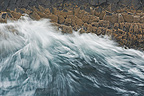 Waves breaking on the basaltic rocks in Iceland