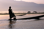 Silhouette of a man on his boat Burma