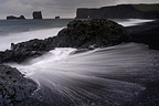 Black sand beach and volcanic rocks Dyrholaey Iceland