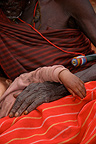 Ndorobo old man's hand holding his son Tanzania
