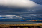 Overcast sky over a fjord in winter Varanger Norway