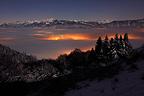 Cloud sea at night at the foot of Aravis massif France