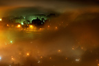 City of Annecy in the fog at night in winter