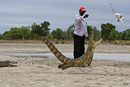 Man attracting Crocodile with chicken Bazoul� Burkina Faso� (Nile Crocodile )