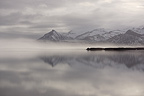 Mountains and clouds reflecting in a lake Iceland