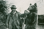 Pyrenean Bear leader showing a bear in 1910 France (Pyrenean Bear)