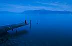 Lonely woman on the shore of the lake Geneva