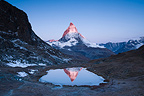Matterhorn reflected in Riffelsee at sunrise Switzerland