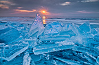Shards of ice against the rising sun, Lake Superior, Minnesota, USA.