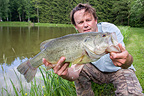 Fisherman and Black-bass Franche-Comte France  (American black Bass)