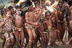 Children dancing with hat and bow Papua New-Guinea