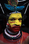 Portrait of a Huli man wearing traditional dress an paint, Papua New-Guinea
