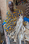 Man and articles snakeskin on a stall Bamako Mali