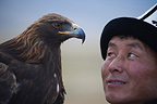 Falconner looking her female eagle Kyrgyzstan (Golden Eagle)