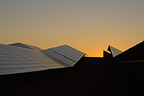 Installation of solar panels at sunrise, Puyloubier, France